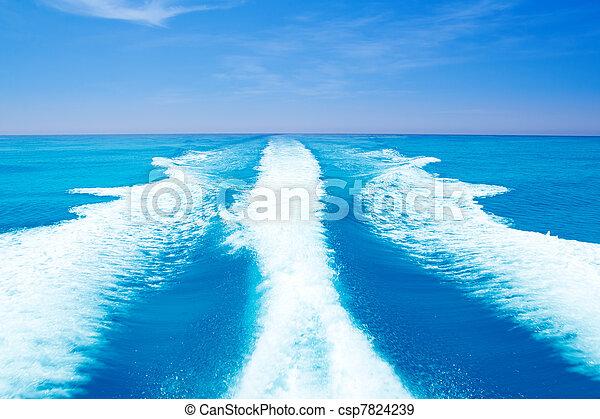 Boat wake prop wash on turquoise sea - csp7824239