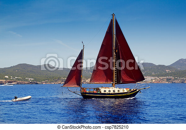Ibiza Red sails sailboat in Sa Talaia coast - csp7825210