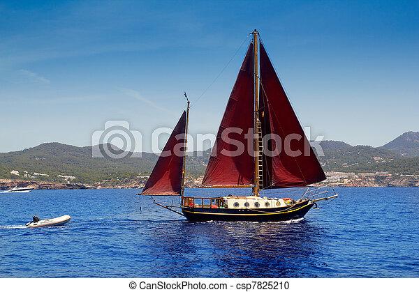 Ibiza Red sails sailboat in Sa Talaia coast - csp7825210