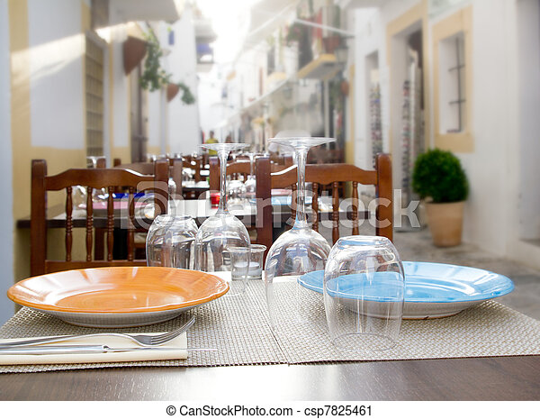 Ibiza island downtown restaurant table - csp7825461