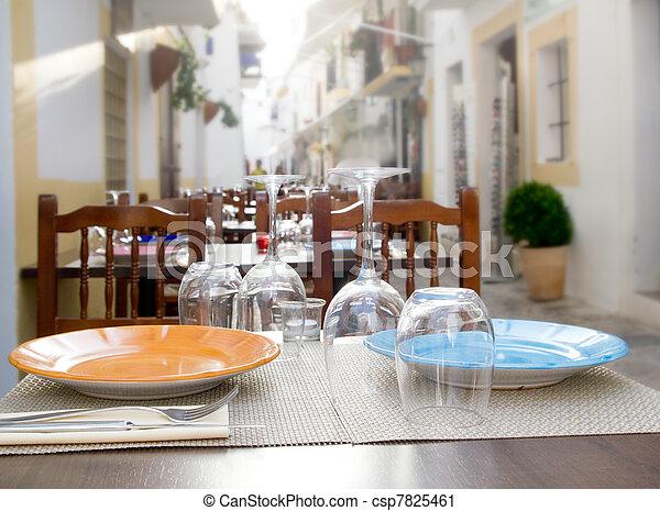 Ibiza island downtown restaurant table - csp7825461