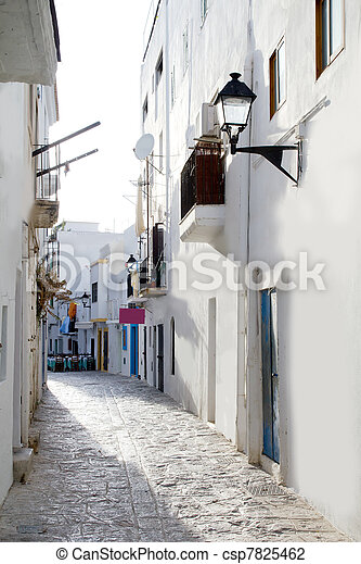 Ibiza downtown white houses narrow street - csp7825462
