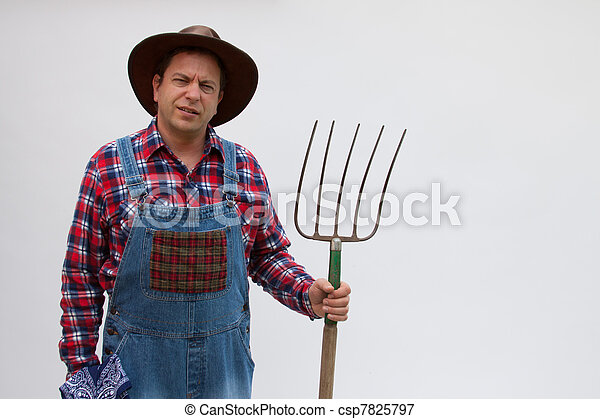 Hillbilly or farmer with pitchfork. - csp7825797