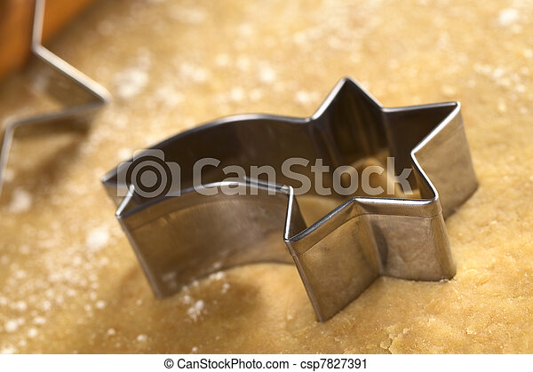 Shooting star shaped cookie cutter on dough - csp7827391