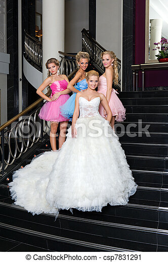 The bride with her bridesmaids on the stairs - csp7831291