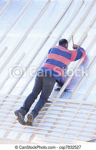 roofer working on a new roof in wood - csp7832527
