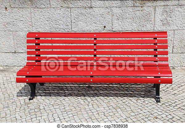 Bright red park bench - csp7838938