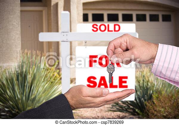 Realator handing over keys to home buyer - csp7839269
