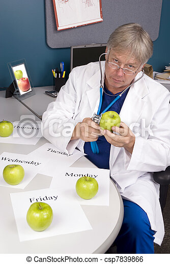 Doctor examines an apple - csp7839866