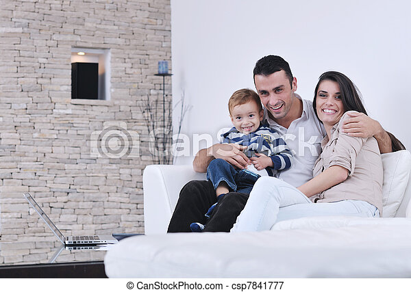 happy young family have fun with tv in backgrund