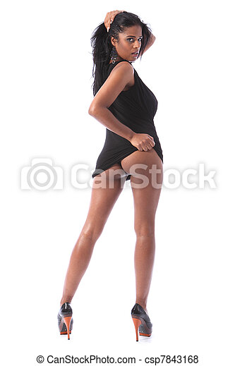 Long legs of sexy black woman in short dress - csp7843168