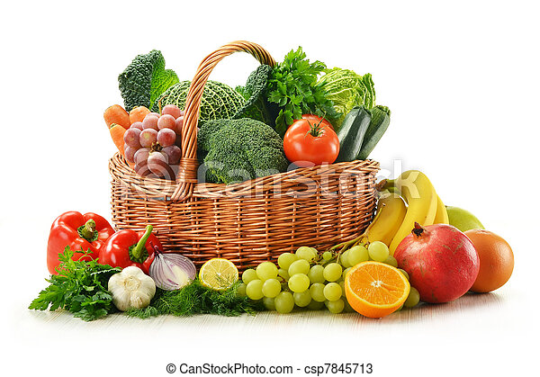 Composition with vegetables and fruits in wicker basket isolated on white - csp7845713