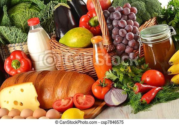Groceries in wicker basket including vegetables and fruits - csp7846575
