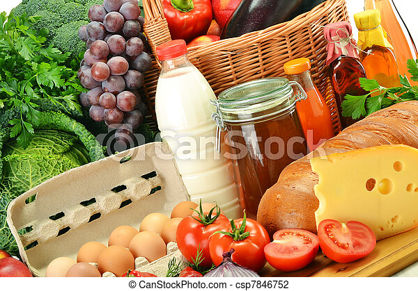 Groceries in wicker basket including vegetables and fruits - csp7846752