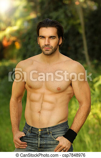 Outdoor portrait of a shirtless good looking fit male model  - csp7848976