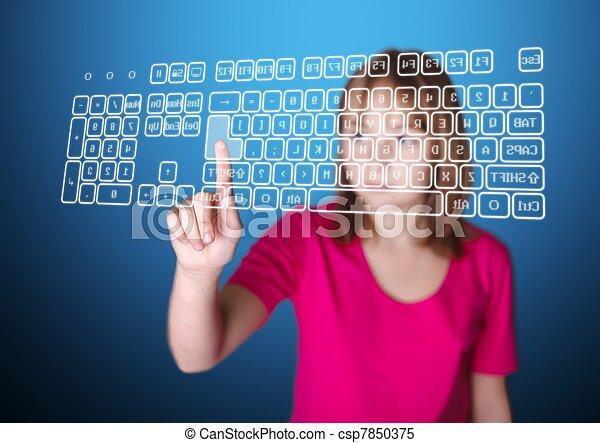 Girl pressing enter on virtual keyboard - csp7850375