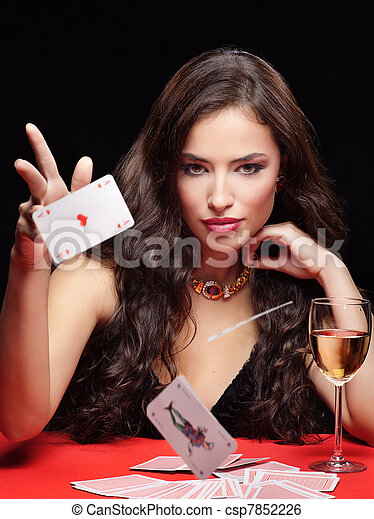 pretty young woman gambling on red table - csp7852226