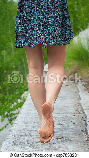 A young woman goes barefoot - csp7853231