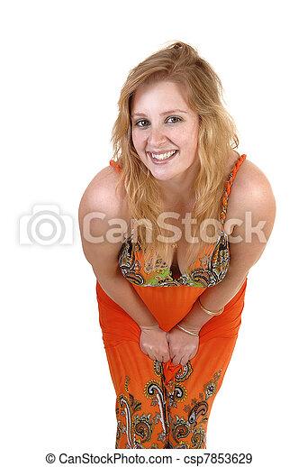 Girl bending to camera. - csp7853629