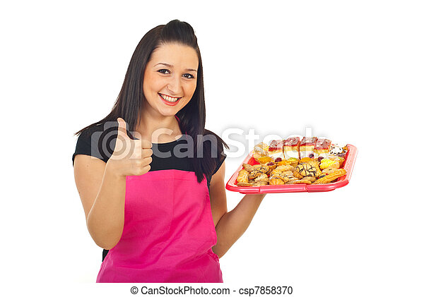 Confectioner with cakes giving thumbs - csp7858370