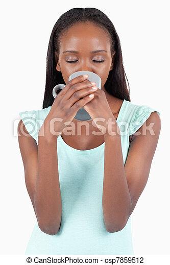 Woman enjoying a sip of tea - csp7859512