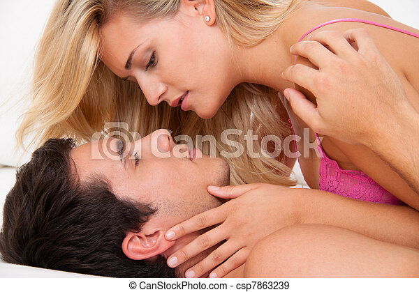 couple in bed during sex and tenderness. - csp7863239