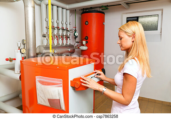 woman in the boiler room for heating - csp7863258