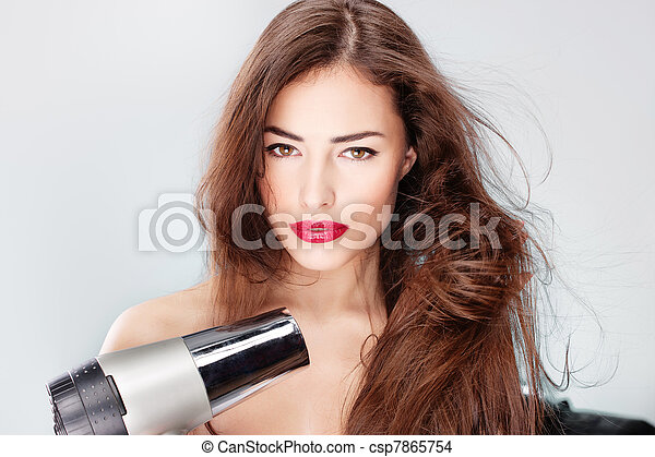 woman with long hair holding blow dryer - csp7865754