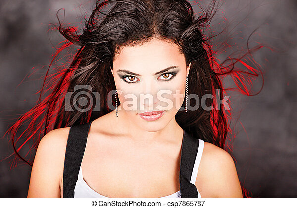 Pretty woman with red light behind her long hair - csp7865787
