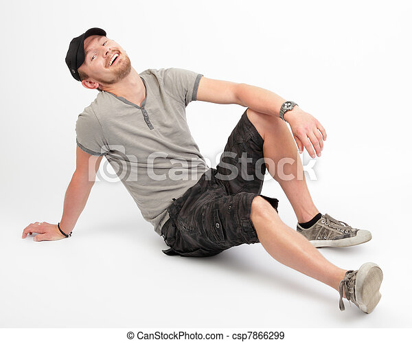 Dude laughing on floor - csp7866299