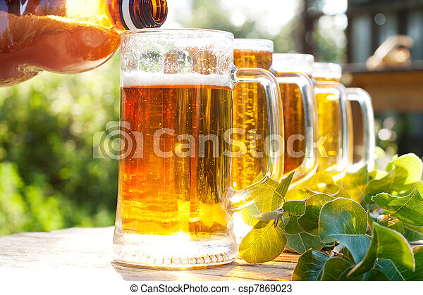 Pour beer in a mug - csp7869023