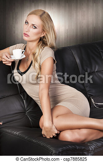 Valuable hot naked girls sitting in the sofa