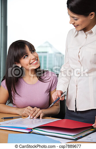 Women Discussing Business Issues - csp7889677