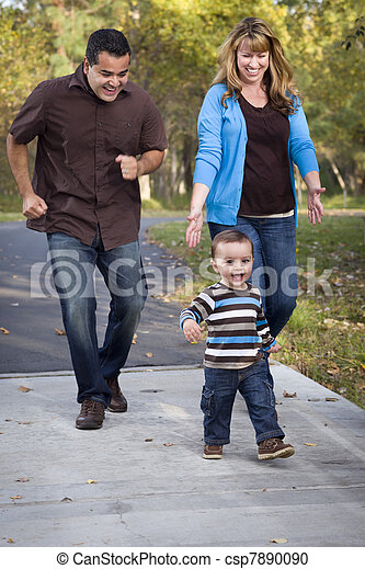 Happy Mixed Race Ethnic Family Walking In The Park - csp7890090