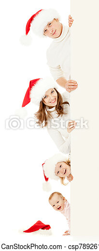 happy family in Christmas Santa's hats holding big banner for your advertisement isolated on white - csp7892614