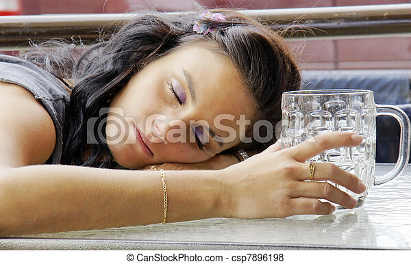 Drunk young woman with beer buck - csp7896198