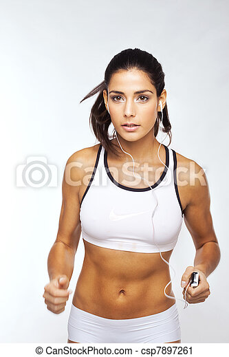 Fit Girl Excercising To Music - csp7897261
