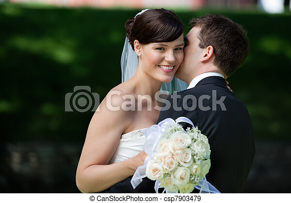 Man Kissing Wife on Cheeks - csp7903479