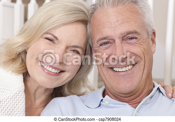 Happy Senior Man & Woman Couple Smiling at Home - csp7908024