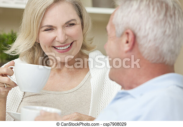 Happy Senior Man & Woman Couple Drinking Tea or Coffee - csp7908029