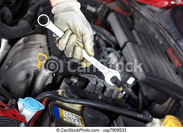 Hand with wrench. Auto mechanic. - csp7908533