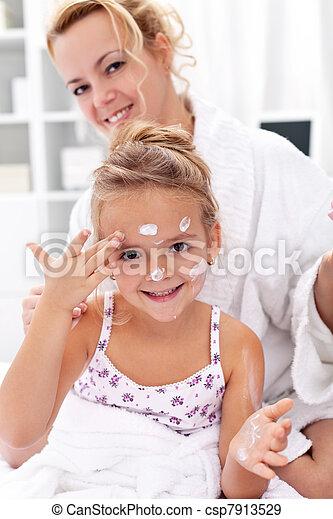 After bath body care - applying face cream - csp7913529