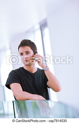 Handsome, young man using his mobile phone