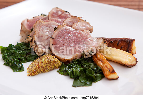 Sliced pork with spinach and parsnips - csp7915394