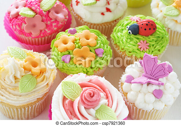 Vanilla cupcakes with various decorations - csp7921360