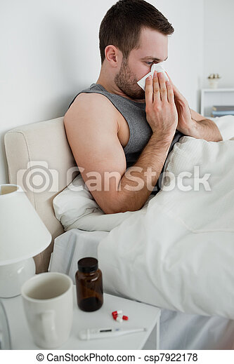 Portrait of a sick man blowing his nose - csp7922178