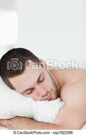 Portrait of a man lying on his belly while sleeping
