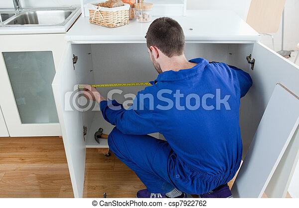 Repair man measuring something - csp7922762