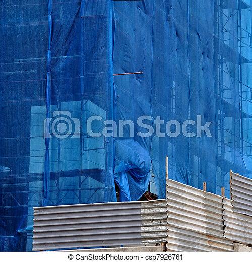 building under debris netting at construction site - csp7926761
