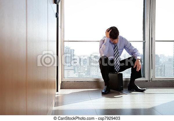 Upset Business man Sitting on Briefcase - csp7929403